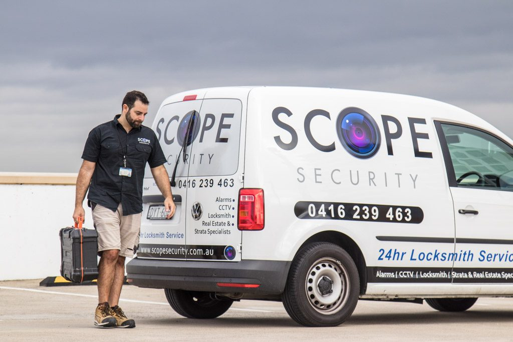 tom from scope security walking away from the mobile locksmith van looking down