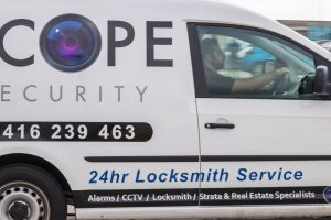 Scope Security locksmith van driving on road